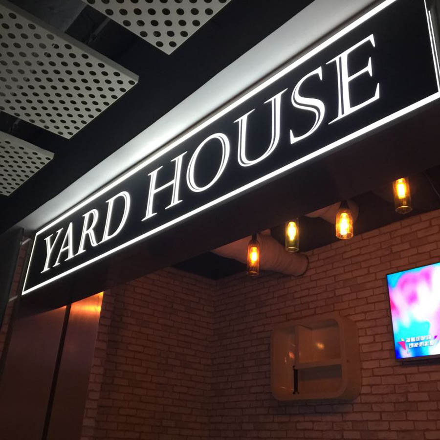 Yard House sign and bar lights in Asia